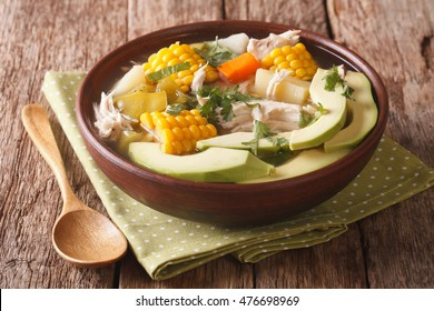 Colombian cuisine: ajiaco soup with chicken and vegetables close up in a bowl on the table. horizontal