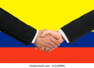 The Colombian flag and business handshake