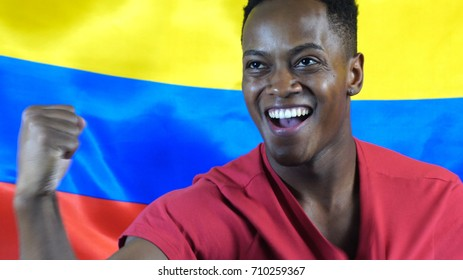 Colombian Guy Win with Colombia Flag