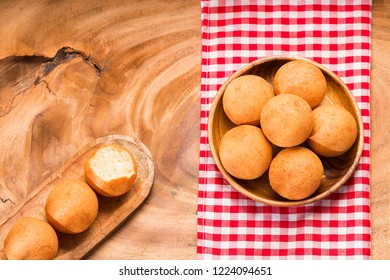 Buñuelos Colombian traditional food - Wood background