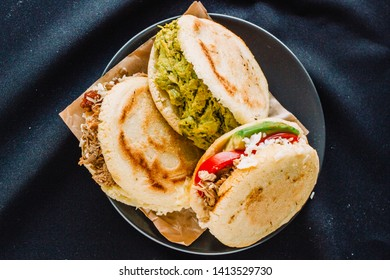 Colombian or venezuelan arepas on a flatlay view, black background