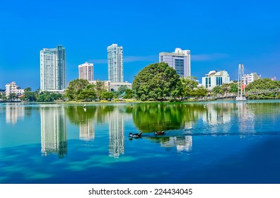 Colombo Beira Lake And Skyline, A Lake In The Heart Of The City Of Colombo That Surrounded By Many Large Businesses In The City