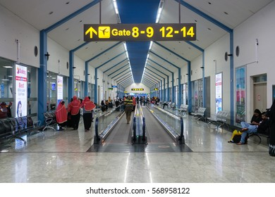 COLOMBO, SRI LANKA - 11 DEC 2016:  International terminal interior in Bandaranaike airport with passengers on a corridor.