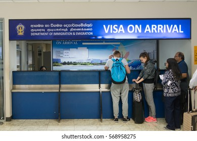 COLOMBO, SRI LANKA - 11 DEC 2016: Visa on arrival stand in international terminal  of Bandaranaike airport with waiting in line tourists.