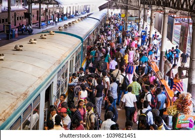 COLOMBO, SRI LANKA - DEC 24,, 2016: Unidentified passengers at Fort Railway Station in Colombo on Dec 24, 2016, Sri Lanka. Fort Railway Station is a major rail hub in Colombo and was opened in 1908.
