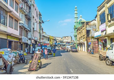 COLOMBO, SRI LANKA - DECEMBER 6, 2016: Wolfendhal street of Pettah, occupied with stores and warehouses, the Jumma Mosque is seen on the background, on December 6 in Colombo.