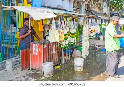 COLOMBO, SRI LANKA - DECEMBER 7, 2016: The stall with fragrant flower garlands of jasmine and marigold in Sea street, next to the historic Hindu Temples, on December 7 in Colombo.