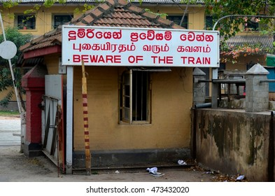 Colombo, Sri Lanka - February 2, 2015: A guardhouse adjacent to the car park barrier entrance to National Railway Museum. A heritage railways Beware of Train sign in English & Sinhalese is posted..