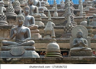 Colombo, Sri Lanka, Gangaramaya Buddhist temple architecture. Many Buddha statues.