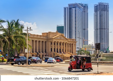 Colombo, Sri Lanka - January 12, 2018. Building of Old Parliament (Secretariat of the president Sri Lanka) against the backdrop of modern skyscrapers on a sunny day