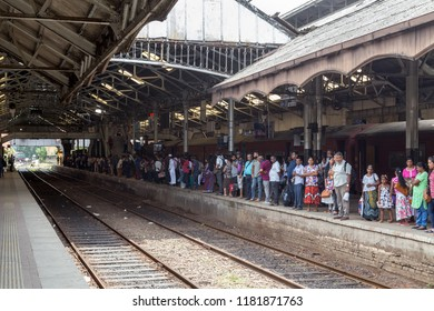 Colombo, Sri Lanka - July 26, 2018: People waiting for a train on the station platform