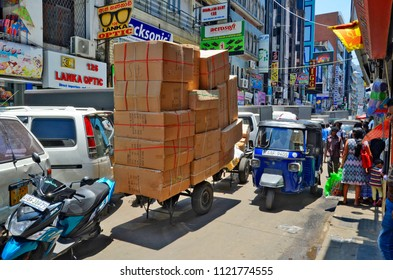 Colombo, Sri Lanka, March 29, 2018 - The bustling and noisy streets of Pettah Market full of vendors, workers and customers.
