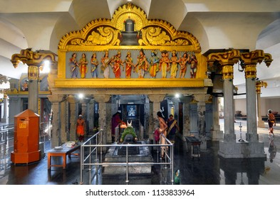 Colombo, Sri Lanka - March 29, 2018: Worshippers inside Sri Muthu Vinayagar Swamy Kovil. A kovil is an Hindu temple with Dravidian architecture.