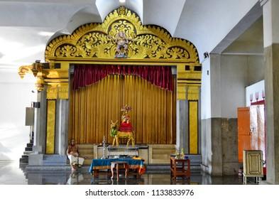 Colombo, Sri Lanka - March 29, 2018: Worshipper inside Sri Muthu Vinayagar Swamy Kovil. A kovil is an Hindu temple with Dravidian architecture.
