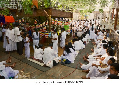 Colombo, Sri Lanka - May 17, 2011: Unidentified people celebrate Vesak religious festival in a Buddhist temple in Colombo, Sri Lanka.