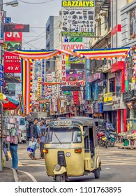COLOMBO, SRI LANKA - May 4, 2018: An iconic trishaw, a modernized version of he rickshaw, is the most popular form of transportation in downtown Colombo, Sri Lanka.