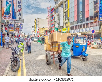 COLOMBO, SRI LANKA - May 4, 2018: Goods are still transported in a traditional way in the downtown area of otherwise highly modern Colombo, Sri Lanka.