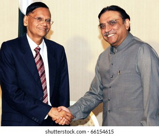 COLOMBO, SRI LANKA - NOV 28: President, Asif Ali Zardari, shakes hand with Sri Lanka External Affairs Minister, Prof.G.L.Peiris during meeting on November 28, 2010 in Colombo.
