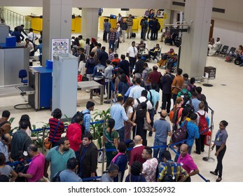 Colombo, Sri Lanka - November 11, 2017:  Passengers waiting in the queue at the security checkpoint in the departure terminal of  Bandaranaike International Airport.