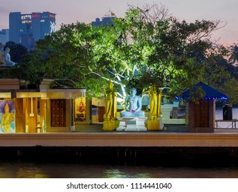 Colombo, Sri Lanka - November 11, 2017: The scenery of Gangaramaya Seema Malaka  temple in the Beira Lake after sunset.
