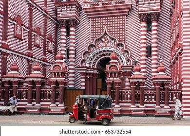 COLOMBO, SRI LANKA - NOVEMBER 28, 2016: The decorative red-and-white facade of Jamiul Alfar Mosque, built in 1908, in the heart of the bazaar of Pettah, one of the oldest districts in Colombo.