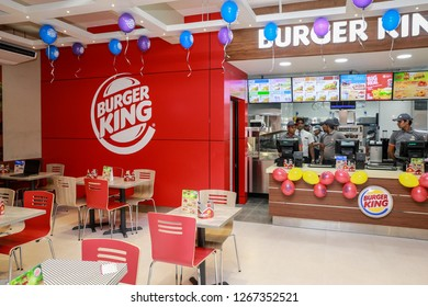 COLOMBO, SRI LANKA - SEPTEMBER 25, 2018:  Inside Tables, Seating, Cashier Counter, and Logo Wall at a Burger King Restaurant. Burger King is an American global chain of hamburger fast food restaurant