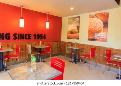 COLOMBO, SRI LANKA - SEPTEMBER 25, 2018:   Tables and Seating at a Burger King Restaurant. Burger King is an American global chain of hamburger fast food restaurant.