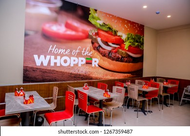 COLOMBO, SRI LANKA - SEPTEMBER 25, 2018:  Inside Tables and Seating at a Burger King Restaurant. Burger King is an American global chain of hamburger fast food restaurant.