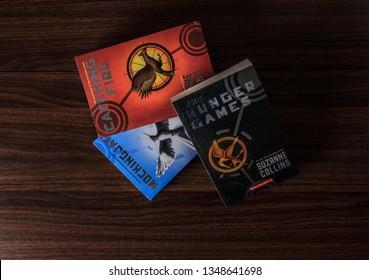 Colombo, Sri Lanka - September 25, 2018 : Hunger Games Trilogy. Three of Hunger Games Novel Books on a Wooden Floor