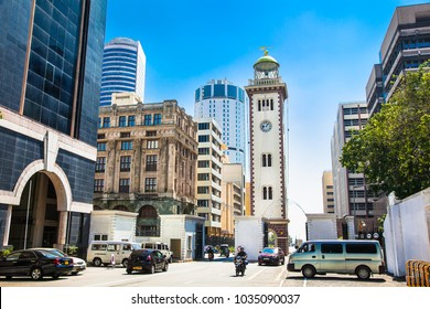 COLOMBO, SRI LANKA-DEC 24, 2016:The historic building of the lighthouse nowadays located among the highrises of the Fort district and functioning as the clock tower Colombo on Dec 24, 2016. Sri Lanka.