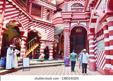 COLOMBO, SRI LANKA-FEBRUARY 20, 2019: Various people inside Red Mosque Jami-Ul-Alfar in Colombo capital of Sri Lanka, Islamic man washing or performing ablution for Ramadan holy month