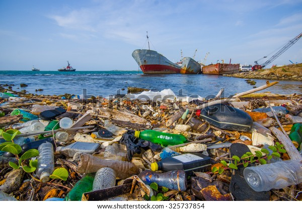 COLON, PANAMA - APRIL 15, 2015: Waste and pollution washing on the shores of the beach in city of Colon in Panama