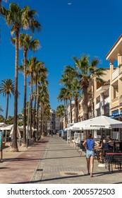 Colonia de Sant Jordi, Spain; july 02 2021: Promenade of the Mallorcan town of Colonia de Sant Jordi with tourists strolling along the promenade