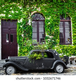 COLONIA DEL SACRAMENTO, URUGUAY - FEBRUARY 03, 2018: Old car parked in historic quarter in Colonia del Sacramento, Uruguay. Colonia del Sacramento is one of the oldest towns in Uruguay.