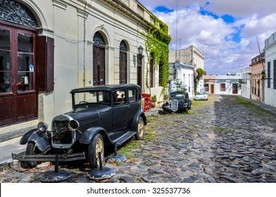 COLONIA DEL SACRAMENTO, URUGUAY - MARCH 26, 2012: Old black automobile on the street of Colonia del Sacramento, a colonial city in Uruguay.