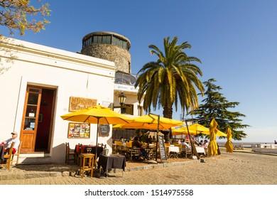 Colonia Sacramento, Uruguay, september, 26: Tourists enjoy a rest in a bar in the sea port of Mar del Plata in the colonial city of Colonia de Sacramento, Uruguay.