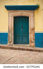 Colonial Blue Doorway on Cobblestone Street in Guanajuato, Mexico