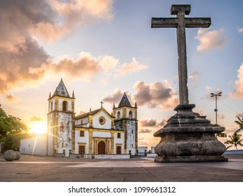 The colonial buildings of the historic Brazilian city of Olinda in Pernambuco, Brazil with its cobblestone streets and catholic church at sunrise.