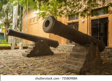 Colonial canons guard the entrance to the museum at San Pedro Sula, Honduras.