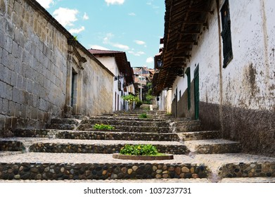 Colonial staircase in the beautiful town of Cajamarca, in Peru. small stones walk uo towards the blue sky where colonial meets tradition.