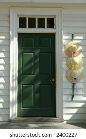 Colonial style hats adorn doorway