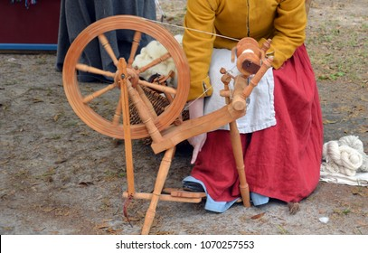 colonial woman spinning yarn