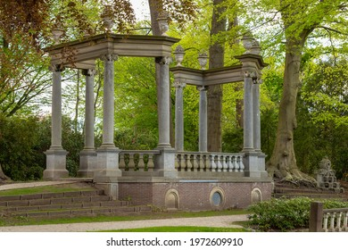 A colonnade built on an octagonal floor plan with eight Ionic columns, four of which are replicas of eighteenth-century vases in Canyons Park in Baarn. - Shutterstock ID 1972609910