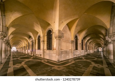 Colonnade of Doge's palace at night, Venice, Italy