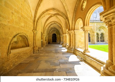 Colonnade of gothic romanesque cloister of old Cathedral of Coimbra. Se Velha de Coimbra, is one of most important romanesque buildings in Portugal and a popular landmark in Coimbra, northern Portugal