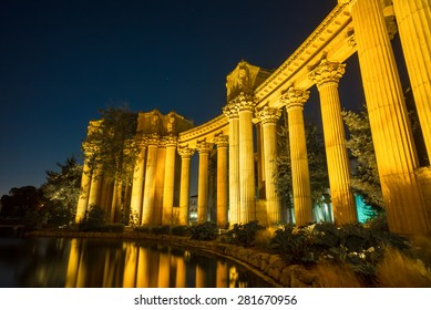 Colonnade pillars at the Palace of Fine Arts Museum at Night in San Francisco, California, USA