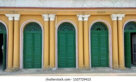 Colonnial arches and wooden doors