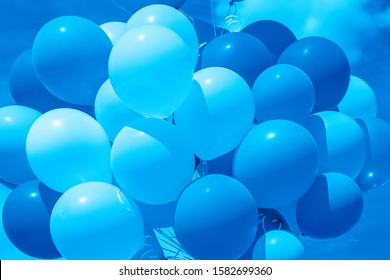 Color of 2020 year, classic blue. Group of balloons with helium on the sky background. Trend color