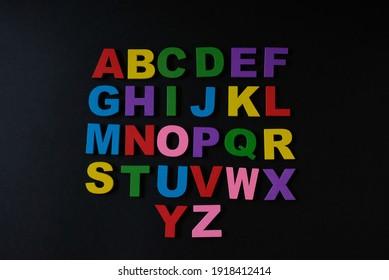 Color alphabet on black background