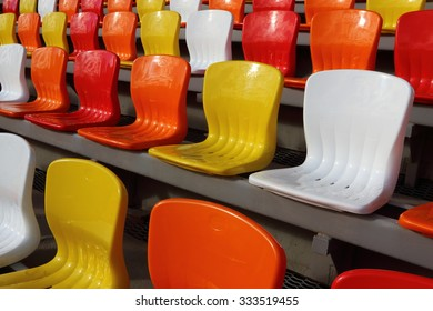 Color armchair rows of a modern stadium in the sunny day